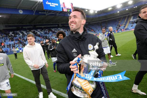 Christian Fuchs of Leicester City with the FA Cup trophy during a lap of the pitch after the Premier League match between Leicester City and...