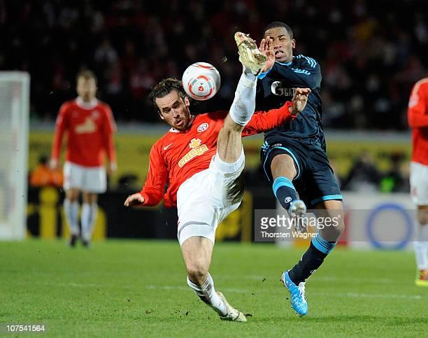 Christian Fuchs of Mainz battles for the ball with Jefferson Farfan of Schalke during the Bundesliga match between FSV Mainz 05 and FC Schalke 04 at...