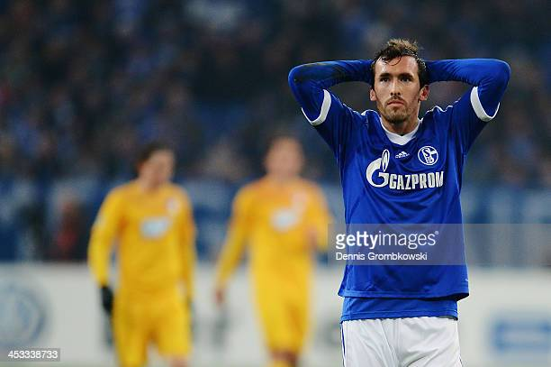 Christian Fuchs of Schalke 04 shows his frustration during the DFB Cup match between Schalke 04 and 1899 Hoffenheim at VeltinsArena on December 3...