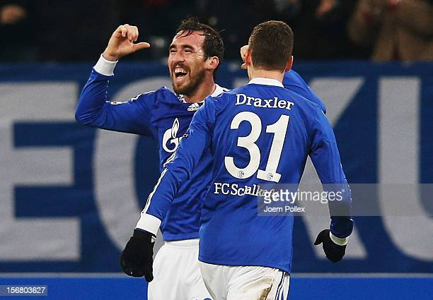 Christian Fuchs of Schalke celebrates with his team mate Julian Draxler after scoring his team's first goal during the UEFA Champions League group B...