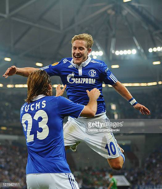 Christian Fuchs of Schalke celebrates with team mate Lewis Holtby after scoring his team's opening goal during the UEFA Europa League group J match...