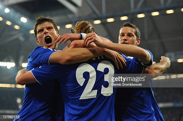 Christian Fuchs of Schalke celebrates with team mates after scoring his team's opening goal during the UEFA Europa League group J match between FC...