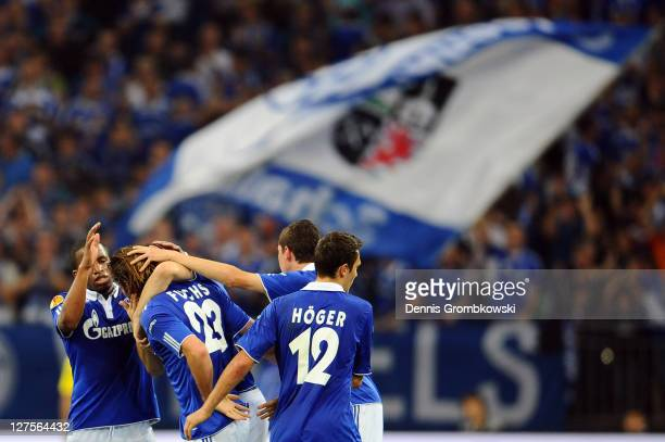 Christian Fuchs of Schalke celebrates with team mates after scoring his team's second goal during the UEFA Europa League group J match between FC...