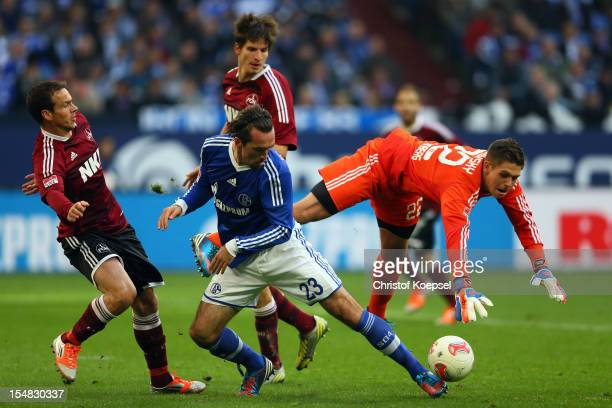 Christian Fuchs of Schalke challenges Patrick Rakovsky of Nuernberg during the Bundesliga match between FC Schalke 04 and 1 FC Nuernberg at...