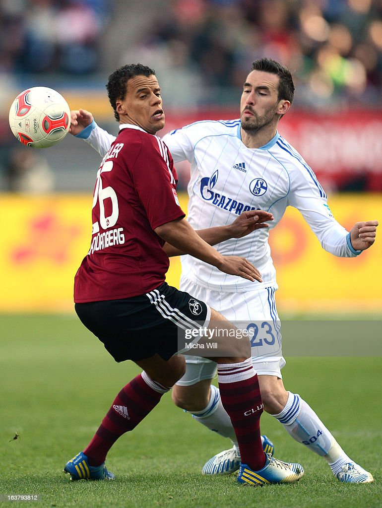 Christian Fuchs (R) of Schalke challenges Timothy Chandler of Nuernberg during the Bundesliga match between 1. FC Nuernberg and FC Schalke 04 at Grundig-Stadion on March 16, 2013 in Nuremberg, Germany.