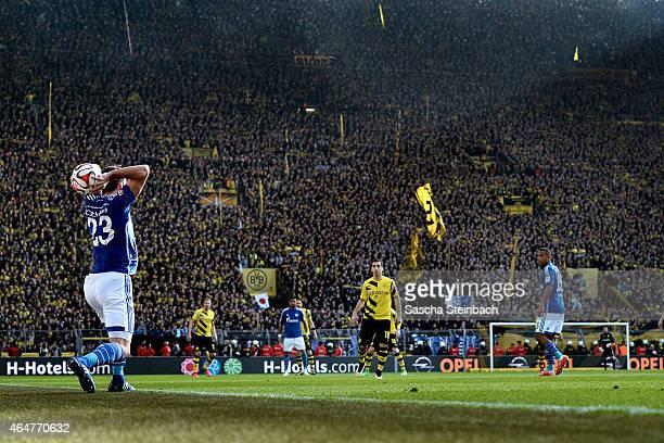 Christian Fuchs of Schalke throws the ball during the Bundesliga match between Borussia Dortmund and FC Schalke 04 at Signal Iduna Park on February...