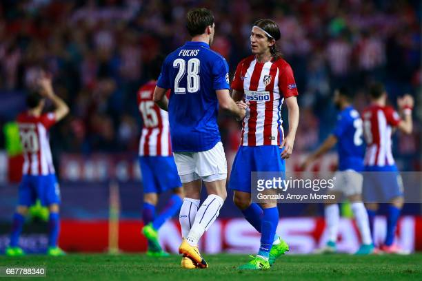 Christian Fuchs shakes hands with Filipe Luis of Atletico de Madrid after the UEFA Champions League Quarter Final first leg match between Club...