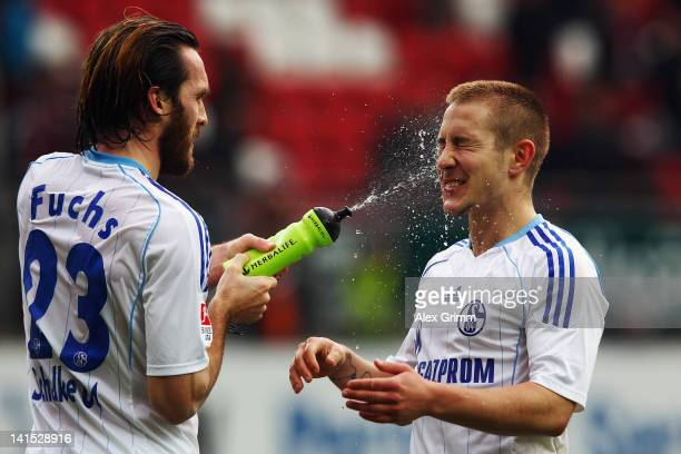 Christian Fuchs splashes water on team mate Lewis Holtby after the Bundesliga match between 1 FC Kaiserslautern and FC Schalke 04 at...