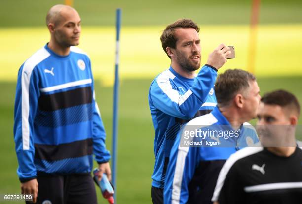 Christian Fuchs uses his mobile phone during a Leicester City training session ahead of their UEFA Champions League QuarterFinal match against...