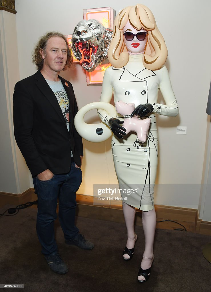 Christian Furr and Pandemonia attend The 'BE INSPIRED' art exhibition in aid of Save Wild Tigers, curated by Christian Furr at the Club at Cafe Royal from 22nd September until 8th October 2015 at Cafe Royal on September 22, 2015 in London, England.