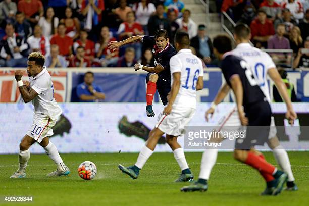 Christian Gamboa of Costa Rica takes a shot against the the United States during the first half at Red Bull Arena on October 13 2015 in Harrison New...