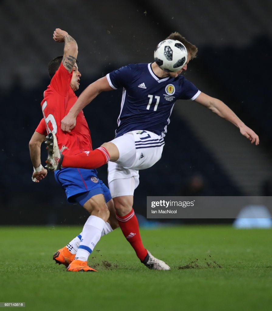 Christian Gamboa of Costa Rica vies with Matt Ritchie of Scotland during the Vauxhall International Challenge match between Scotland and Costa Rica at Hampden Park on March 23, 2018 in Glasgow, Scotland.