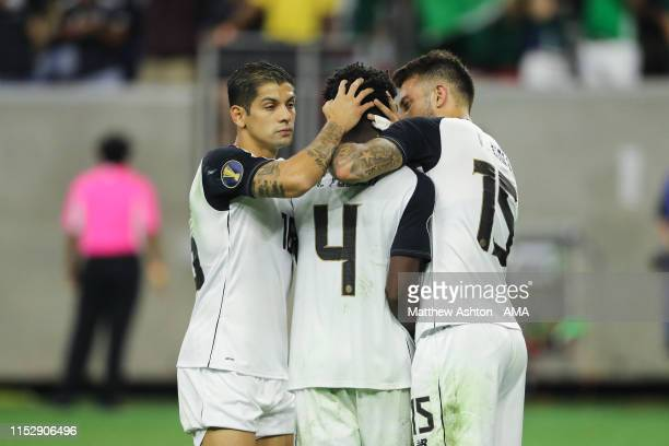 Christian Gambuca and Francisco Calvo console Keysher Fuller of Costa Rica after his penalty miss during the 2019 CONCACAF Gold Cup Quarter Final...
