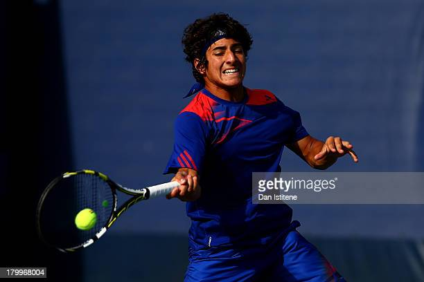 Christian Garin of Chile plays a forehand during the boys' singles semifinal match against Thanasi Kokkinakis of Australia on Day Thirteen of the...