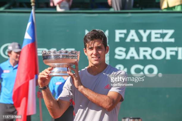 Christian Garin poses with the trophy after winning the US Men's Clay Court Championship singles final on April 14 2019 at River Oaks Country Club in...