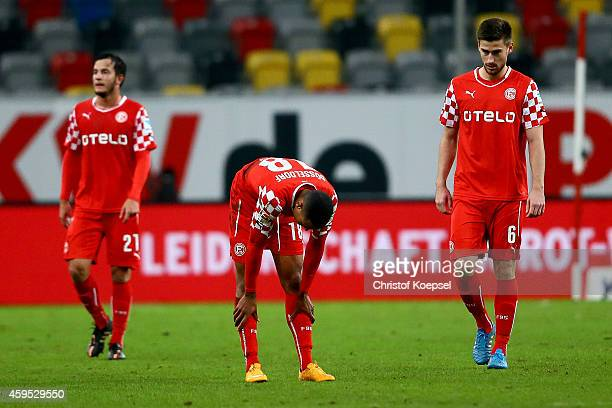Christian Gartner Matthias Bolly and Dustin Bomheuer of Duesseldorf look dejected after the Second Bundesliga match between Fortuna Duesseldorf and...