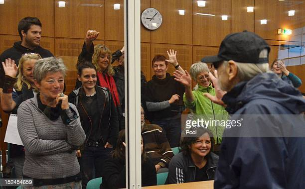 Christian Gauger acknowledges sympathisers in the public gallery as he arrives for the first day of his trial charged in relation to the 1975 OPEC...