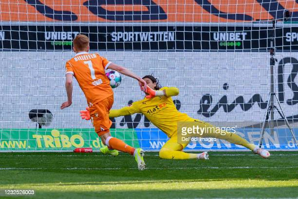 Christian Gebauer of Arminia Bielefeld and goalkeeper Yann Sommer of Borussia Moenchengladbach battle for the ball during the Bundesliga match...