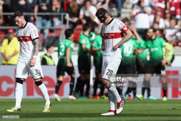 Christian Gentner and Daniel Ginczek of Stuttgart react after Niclas Fuellkrug of Hannover scored his team's first goal during the Bundesliga match...