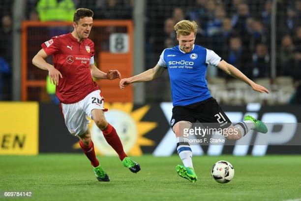 Christian Gentner of Stuttgart and Andreas Voglsammer of Bielefeld fight for the ball during the Second Bundesliga match between DSC Arminia...