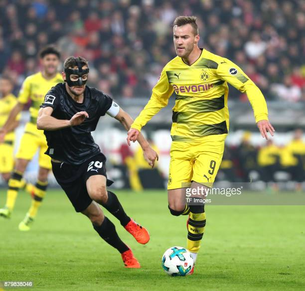 Christian Gentner of Stuttgart and Andrej Yarmolenko of Dortmund battle for the ball during the Bundesliga match between VfB Stuttgart and Borussia...