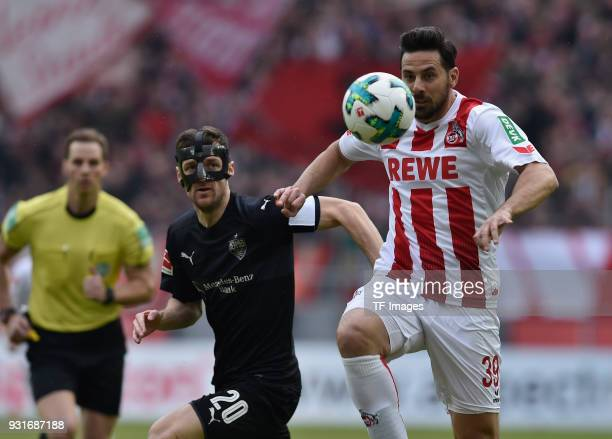 Christian Gentner of Stuttgart and Claudio Pizarro of Koeln battle for the ball during the Bundesliga match between 1 FC Koeln and VfB Stuttgart at...
