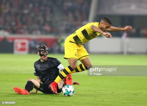 Christian Gentner of Stuttgart and Jeremy Toljan of Dortmund battle for the ball during the Bundesliga match between VfB Stuttgart and Borussia...