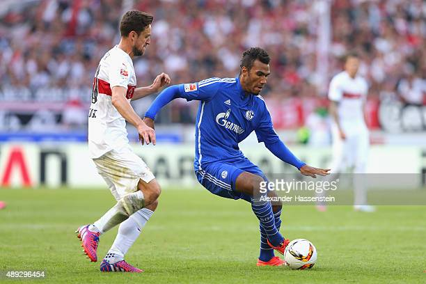 Christian Gentner of Stuttgart battles for the ball with Eric Maxim ChoupoMoting of Schalke during the Bundesliga match between VfB Stuttgart and FC...