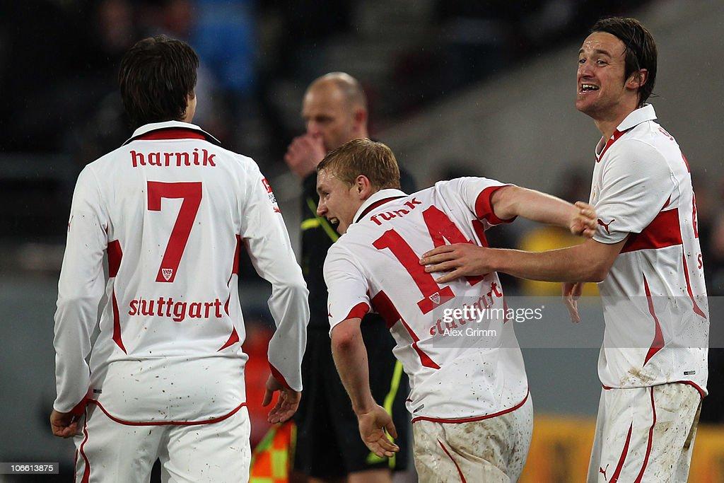 Christian Gentner of Stuttgart celebrates his team's fourth goal with team mates Patrick Funk and Martin Harnik (R-L) during the Bundesliga match between VfB Stuttgart and SV Werder Bremen at the Mercedes-Benz Arena on November 7, 2010 in Stuttgart, Germany.