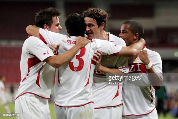 Christian Gentner of Stuttgart celebrates his team's second goal with team mates Martin Harnik Cristian Molinaro and Daniel Didavi during the UEFA...