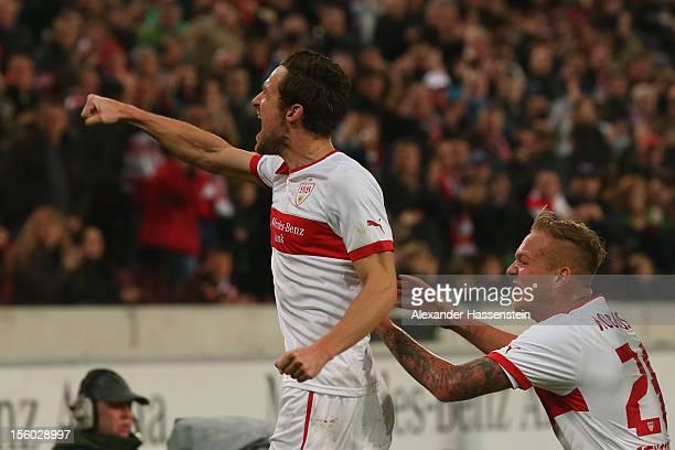 Christian Gentner of Stuttgart celebrates scoring the opening goal with his team mate Raphael Holzhauser during the Bundesliga match between VfB...