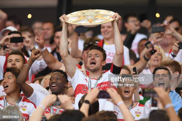 Christian Gentner of Stuttgart celebrates winning the 2 Second Bundesliga Championship title with the Championship trophy after the 2 Second...
