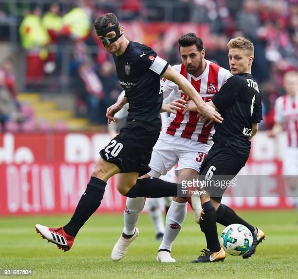 Christian Gentner of Stuttgart Claudio Pizarro of Koeln and Santiagio Lionel Ascacibar of Stuttgart battle for the ball during the Bundesliga match...
