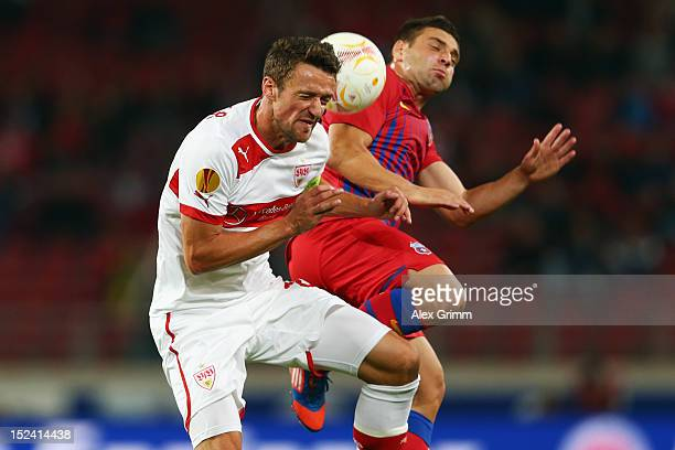 Christian Gentner of Stuttgart is challenged by Adrian Popa of Bucuresti during the UEFA Europa League group E match between VfB Stuttgart and FC...