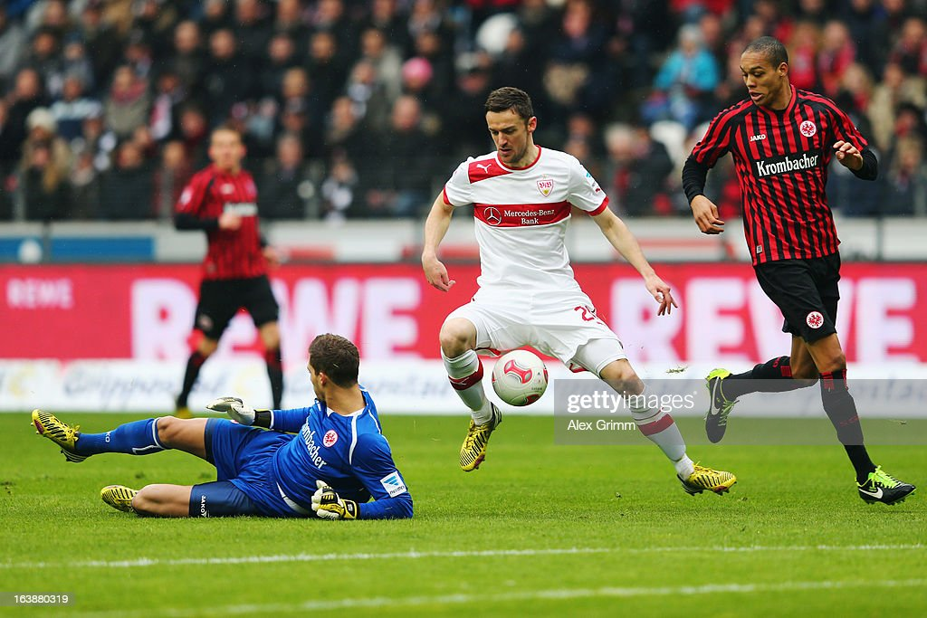 Christian Gentner of Stuttgart is challenged by goalkeeper Kevin Trapp and Bamba Anderson of Frankfurt during the Bundesliga match between Eintracht Frankfurt and VfB Stuttgart at Commerzbank-Arena on March 17, 2013 in Frankfurt am Main, Germany.