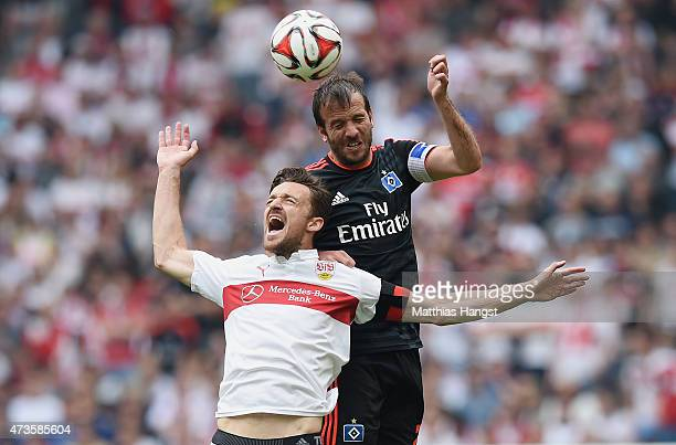 Christian Gentner of Stuttgart jumps for a header with Rafael van der Vaart of Hamburg during the Bundesliga match between VfB Stuttgart and...