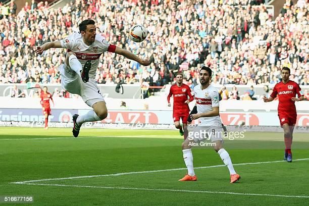 Christian Gentner of Stuttgart jumps for the ball during the Bundesliga match between VfB Stuttgart and Bayer Leverkusen at MercedesBenz Arena on...