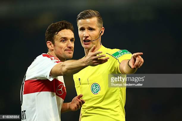 Christian Gentner of Stuttgart talks to referee Arne Aarnink during the Second Bundesliga match between VfB Stuttgart and TSV 1860 Muenchen at...