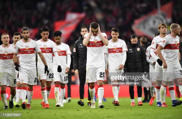 Christian Gentner of VfB Stuttgart and team mates look dejected after the Bundesliga match between FC Bayern Muenchen and VfB Stuttgart at Allianz...