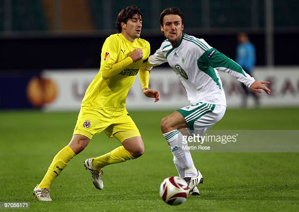 Christian Gentner of Wolfsburg and Cani of Villareal compete for the ball during the UEFA Europa League knock-out round, second leg match between VfL...