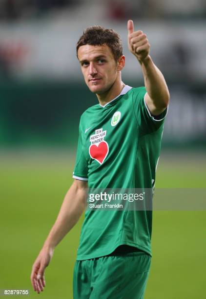 Christian Gentner of Wolfsburg celebrates at the end of the UEFA Cup first round first leg match between VfL Wolfsburg and Rapid Bucharest on...