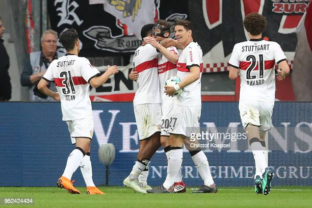 Christian Gentner of Stuttgart celebrates with his team after he scored a goal to make it 01 during the Bundesliga match between Bayer 04 Leverkusen...