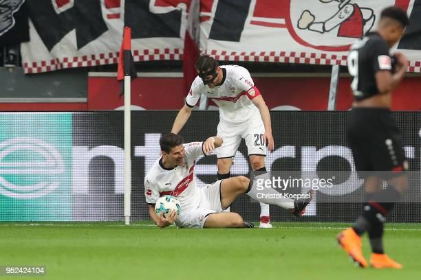 Christian Gentnerof Stuttgart celebrates with Mario Gomez of Stuttgart after he scored a goal to make it 01 during the Bundesliga match between...