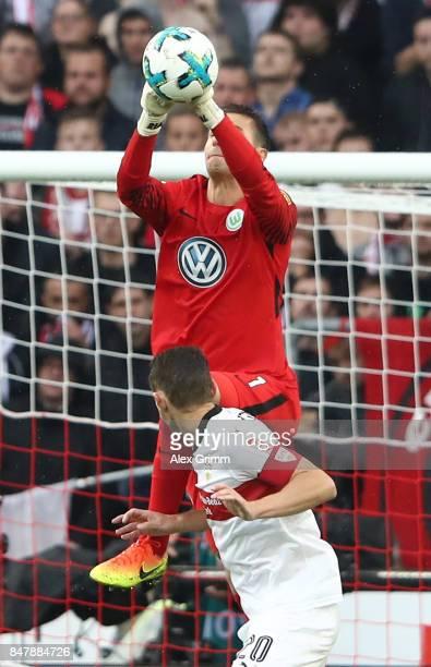 Christian Gentnerof Stuttgart is is being foul by goalkeeper Koen Casteels of Wolfsburg during the Bundesliga match between VfB Stuttgart and VfL...