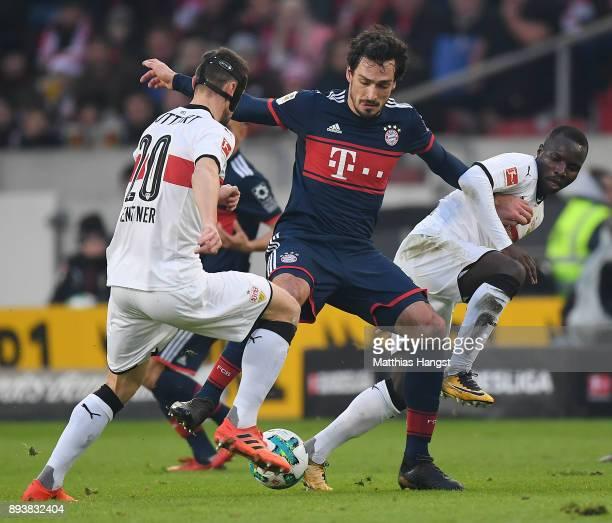 Christian Gentnerof Stuttgart Mats Hummels of Bayern Muenchen and Chadrac Akolo of Stuttgart fight for the ball during the Bundesliga match between...