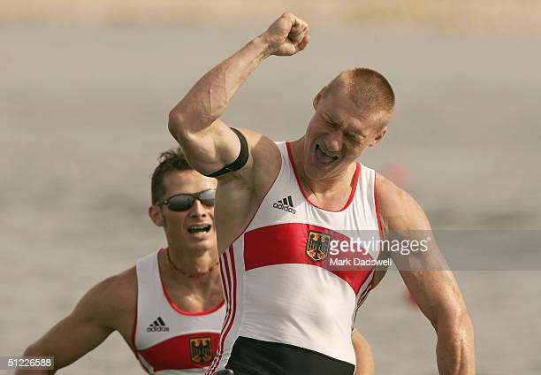 Christian Gille and Tomasz Wylenzek of Germany celebrate winning the men's C2 class 1000 metre final on August 27 2004 during the Athens 2004 Summer...