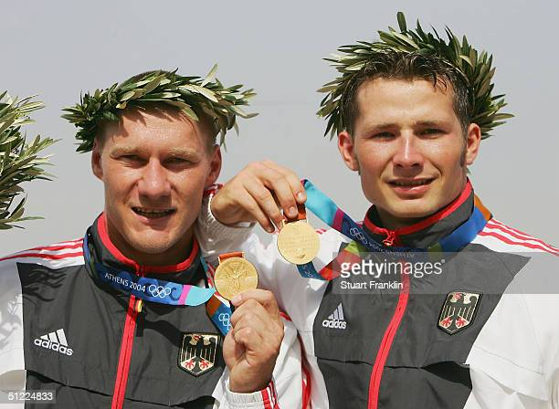 Christian Gille and Tomasz Wylenzek of Germany receives their medals for the men's C2 class 1000 metre event on August 27 2004 during the Athens 2004...