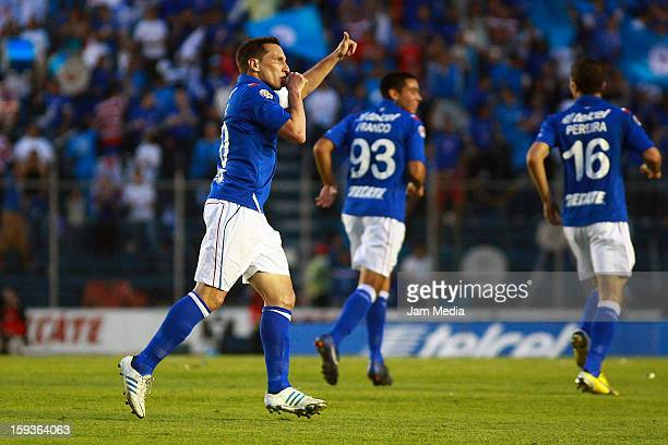 Christian Gimenez of Cruz Azul celebrates a scored goal against San Luis during a match as part of the Clausura 2013 Liga MX at Azul Stadium on...