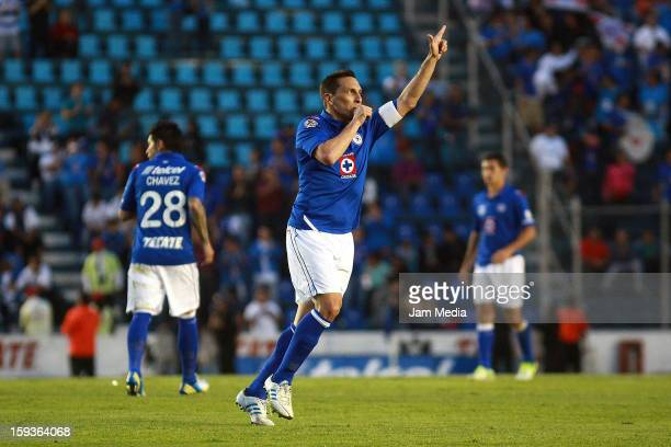 Christian Gimenez of Cruz Azul celebrates a scored goal against San Luis during a match as part of the Clausura 2013 Liga MX at Azul Stadium on...