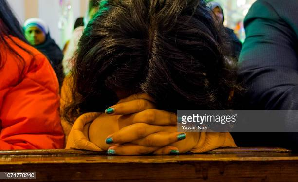 Christian girl prays in the Holy Family Catholic Church during Christmas day on December 25 2018 in Srinagar the summer capital of Indian...